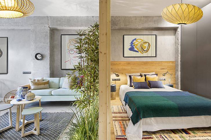 Бетон и дерево: индустриальный дизайн маленькой квартиры в Барселоне (46 кв. м)