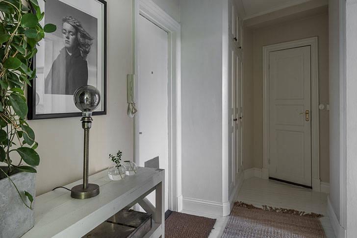 Двухкомнатная квартира в скандинавском стиле с неправильной планировкой (61 кв. м)